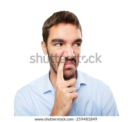 Close up of a young man with gesture of bad smell - stock photo
