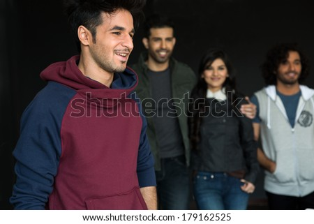 close up of a young man with group of friends in the background - stock photo