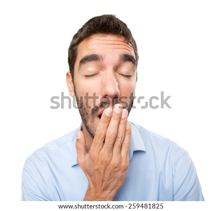 Close up of a young man yawning - stock photo