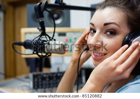 Close up of a young radio host posing in a station - stock photo