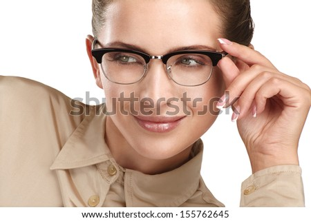 close up of a young smiling beautiful woman wearing eyeglasses  on white - stock photo