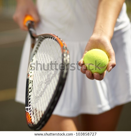 Close up of a young tennis player standing ready for a serve