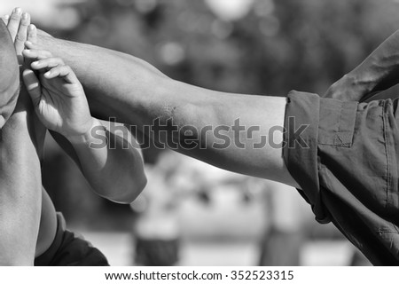 Close-up of a young Thai boxer hands hemp ropes are wrapped before the fight or training, boxing, kick boxing, rope tying, Muay Thai, Thailand.  - stock photo