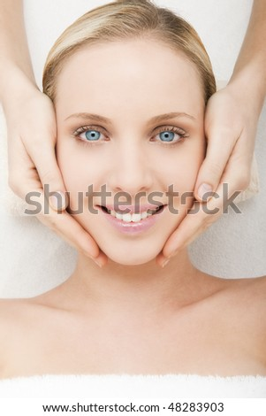 Close-up of a young woman getting spa treatment. - stock photo