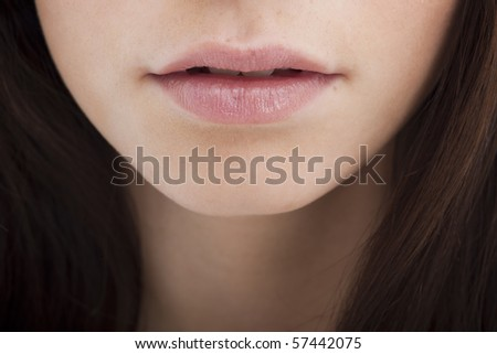 Close-up of a young woman mouth - stock photo
