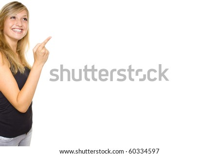 Close-up of a young woman pointing. Lots of copyspace and room for text on this isolate - stock photo
