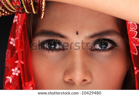 Close-up of a young woman's beautiful face in dancing costume - stock photo