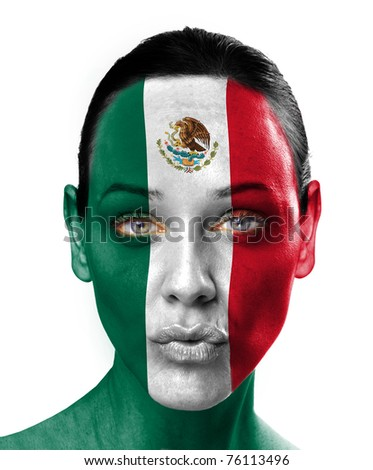 Close up of a young woman with a mexican flag painted on her face - stock photo