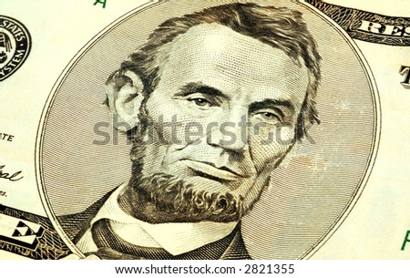 close up of abraham lincoln on the five dollar bill