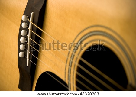 Close-Up of Acoustic Guitar and Strings - stock photo