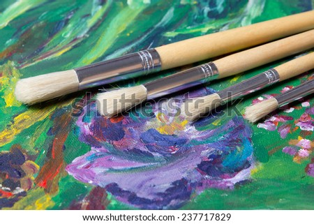 close up of acrylic paint and paint brushes
