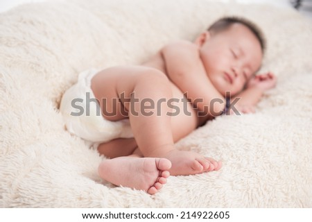 Close up of adorable baby sleeping. Isolated on white blanket. Dream come true - stock photo