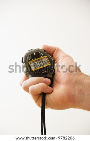 Close-up of adult male hand holding stopwatch. - stock photo