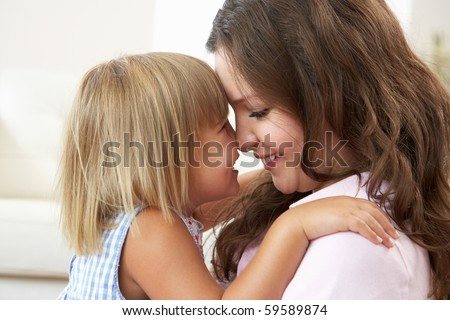 Close Up Of Affectionate Mother And Daughter At Home