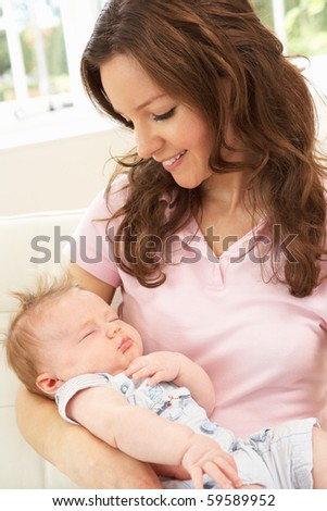 Close Up Of Affectionate Mother Cuddling Baby Boy At Home - stock photo