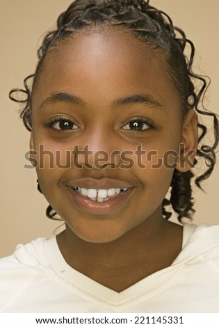 Close up of African American girl smiling - stock photo