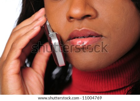 Close-up of African American woman talking on a cell phone - stock photo