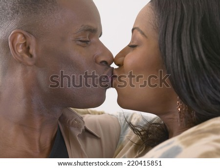 Close up of African couple kissing - stock photo