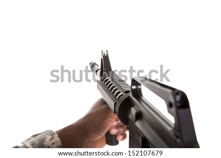 Close-up Of African Soldier Aiming With Gun Over White Background