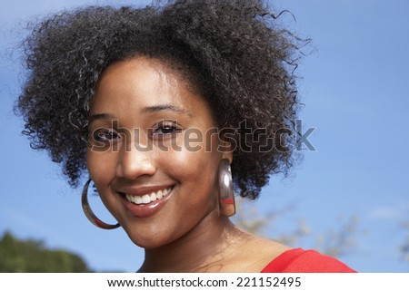 Close up of African woman smiling - stock photo
