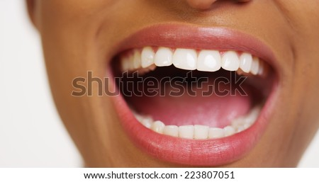 Close up of African woman with white teeth smiling - stock photo