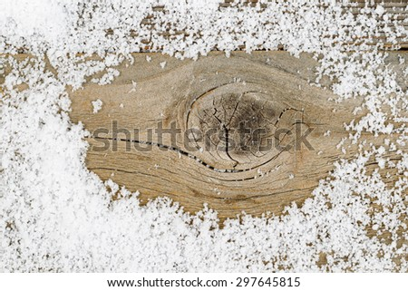 Close up of aged wood with snow. Layout in horizontal format. Winter concept for the Christmas season.    - stock photo