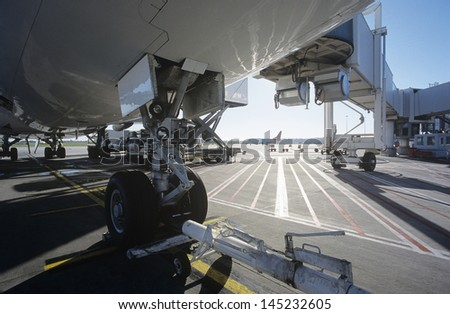 Close-up of airplanes wheel at airport - stock photo
