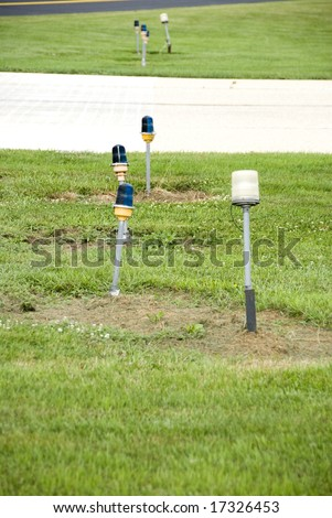 Close-up of airport runway lights in the daytime - stock photo