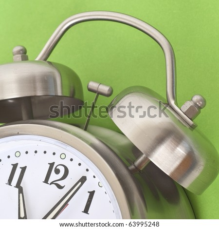 Close Up of Alarm Clock on a Vibrant Background.  Everyday Object Close Up. - stock photo