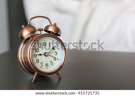 Close up of alarm clock on table in bedroom