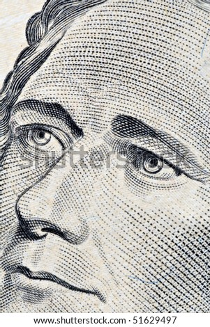 Close-up of Alexander Hamilton's ten dollars portrait - stock photo