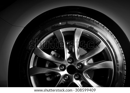 Close-up of aluminium rim of luxury car wheel. Detail background - stock photo