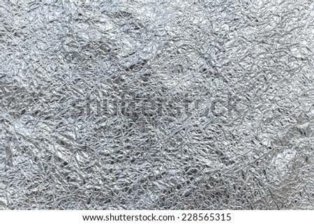 Close up of aluminum foil texture background - stock photo