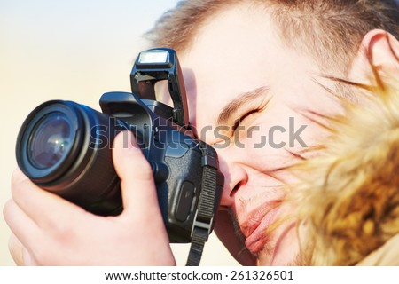 close-up of amateur photographer preparing to photograph - stock photo