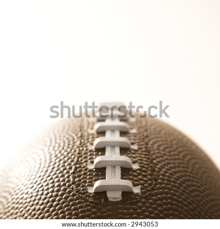 Close-up of American football on white background. - stock photo
