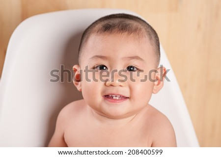 Close up of an adorable baby boy  - stock photo