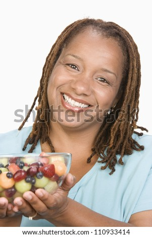 Close-up of an African American obese woman holding a bowl of fruit salad