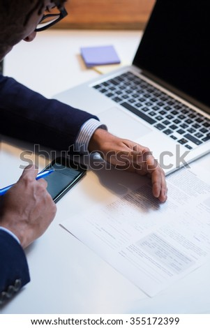 Close-up Of An African Businessperson Signing Contract