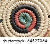 Close-up of an African design on a hand-woven basket. - stock photo