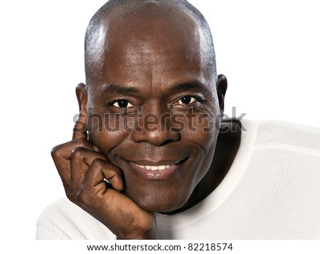 Close-up of an afro American handsome man with hand on chin smiling in studio on white isolated background - stock photo