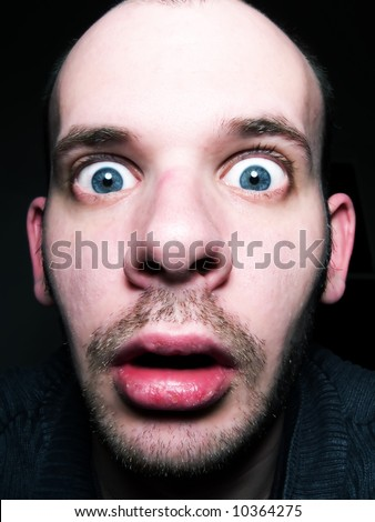 Close-up of an amazed face - stock photo