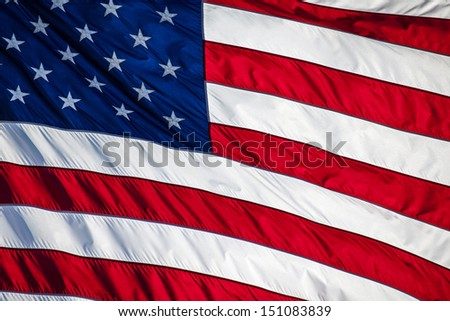 Close up of an American flag blowing in the wind - stock photo