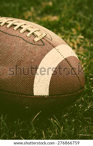 Close up of an american football - retro style - stock photo
