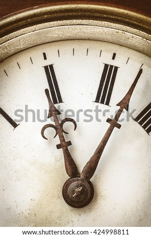 Close up of an ancient weathered clock with rusted minute and hour hands - stock photo