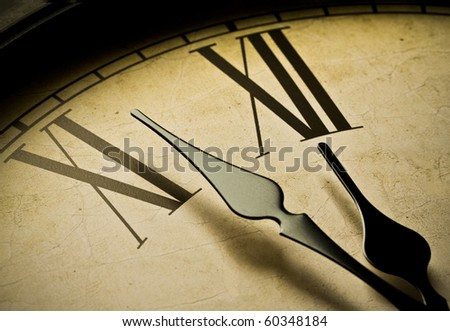 Close up of an antique clock and the time is almost midnight. Concept of time,the past or deadline. - stock photo