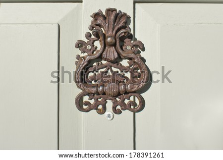 Close up of an antique knocker on a front door