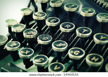 Close up of an antique typewriter keyboard. - stock photo