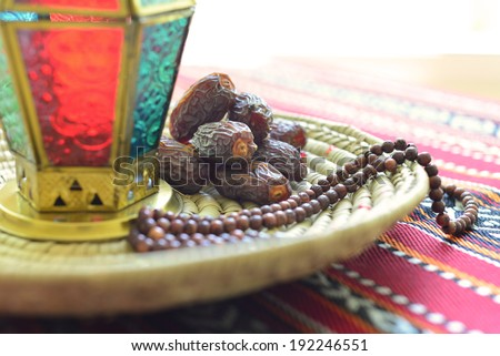 Close up of an arabic dates, lantern and rosary - stock photo