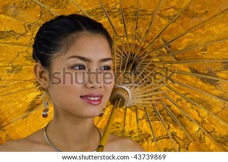 close-up of an asian girl carrying an umbrella - stock photo