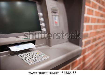Close up of an ATM with a twenty euros notes in it - stock photo